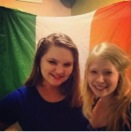 A picture of one of my sweet friends that I made in Ireland and I, in front of the Irish flag